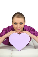 Young woman with a heart-shaped box