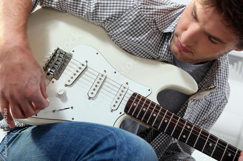 Young man with an electric guitar