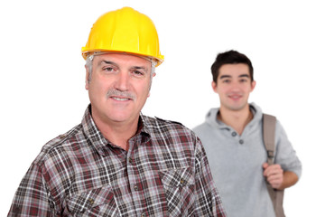 mature craftsman with apprentice