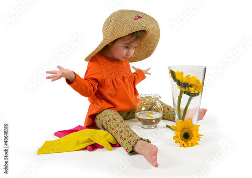 One little girl arranging flowers sitting