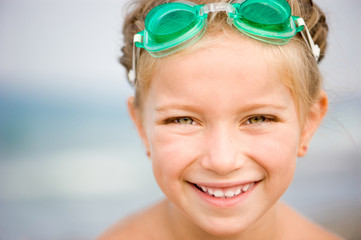Little girl in swimming pool close-up
