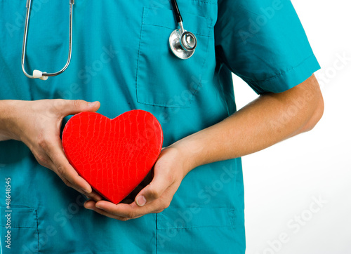 doctor holding a heart symbol