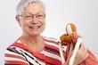 Granny holding rag doll smiling