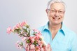 Elderly lady with flowers smiling