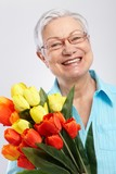Portrait of elderly lady with flowers