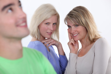 Two girls lusting over man