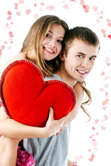 Beautiful smiling couple with red heart. Valentine's day