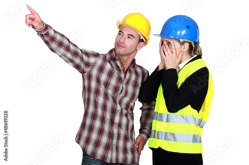 Construction couple discussing a problem