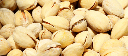 A heap of shelled pistachios