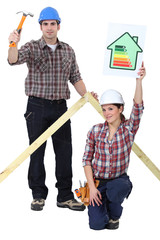 Carpenters holding a hammer and an energy efficiency sign