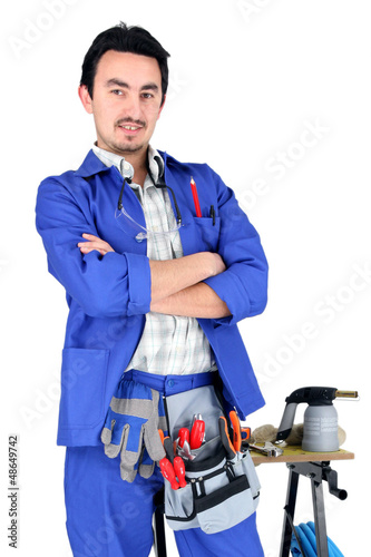 Full length studio shot of a plumber and his tools