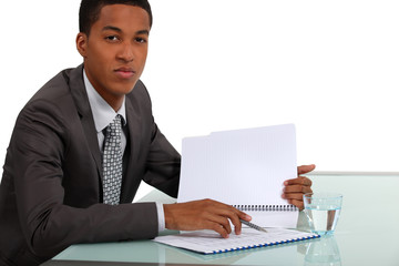 Afro-American businessman reading a report