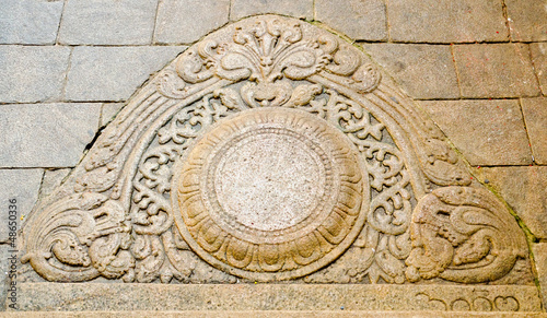 """moon"" stone at the entrance to the buddhist temple"