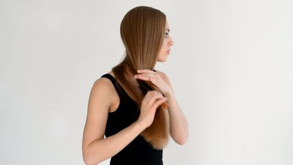 girl combing of her hair