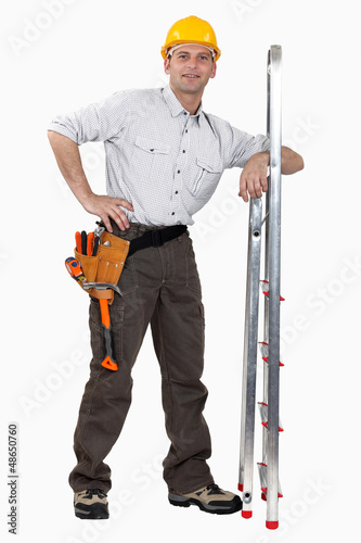 Tradesman leaning against a stepladder