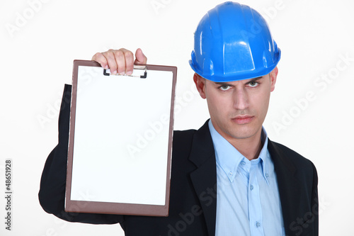 Angry surveyor holding clipboard