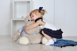 Little girl with hippopotam