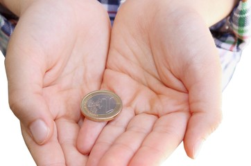 Child's hands  with money on white background
