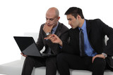 duo of businessman with laptop exchanging views