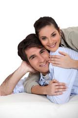 Woman lying on top of boyfriend