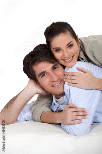 Woman lying on top of boyfriend