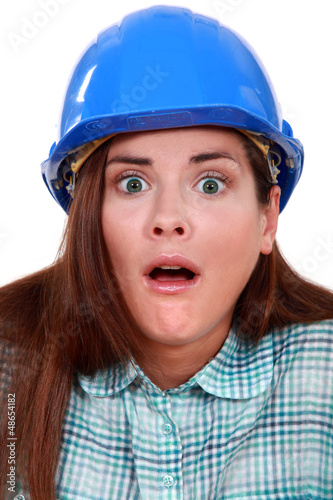 Shocked woman in a hard hat