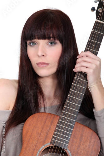 Busker posing with her guitar