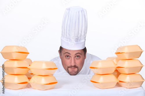 Chef with a pile of takeaway boxes