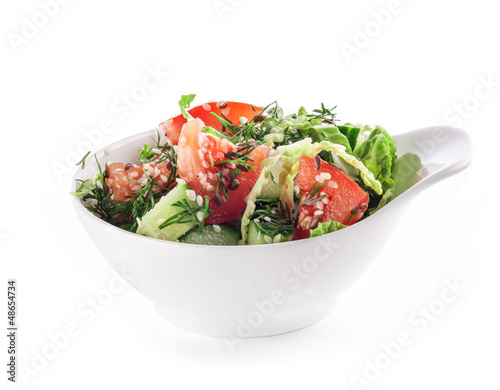 Healthy garden salad in bowl, isolated on white background