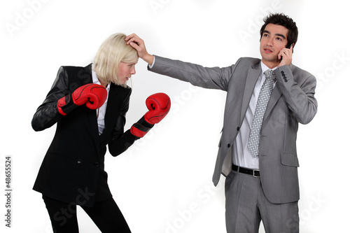 Man taking a break from fighting with his colleague