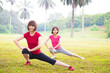 Two Asian girls stretching