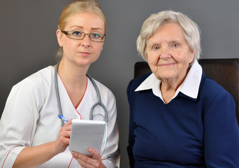 Elderly woman and a young doctor.