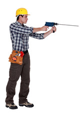 Man with a masonry drill