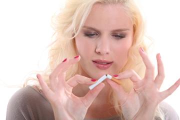 woman breaking a cigarette
