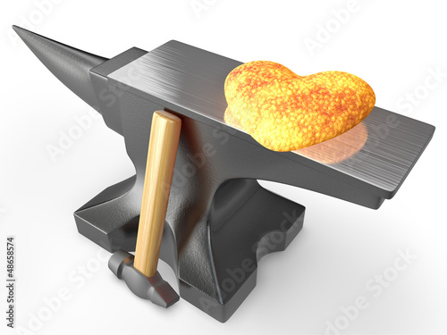 Red hot metal heart on an anvil