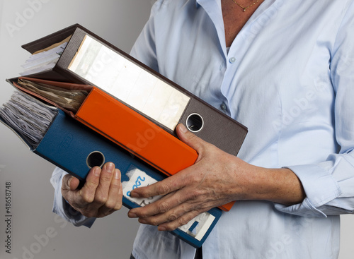 woman carrying binders
