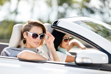 Close up view of girls in the automobile