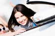 Close up of smiley woman in the automobile