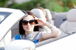 Portrait of dreamy woman wearing sunglasses in the cabriolet
