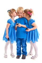 Two girls which twins are kissing a boy