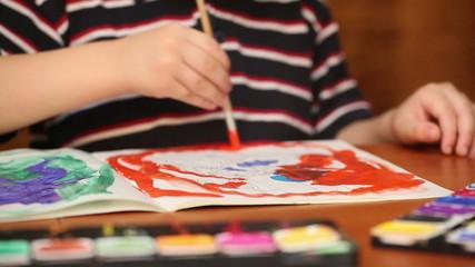 child draws paints 5
