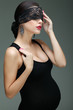 portrait elegant sexual  expectant mother in black clothes