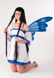 Attractive girl as fairy with wings
