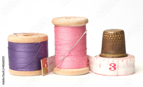 Old thimble and needles with thread