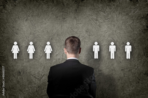 Businessman choosing between people