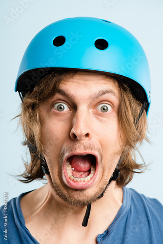 funny man wearing cycling helmet portrait real people high defin