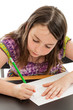 Elementary School Girl Writing at Desk