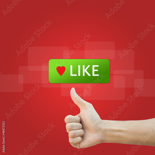 like button with real hand on red background