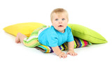 Little boy and color pillows, isolated on white