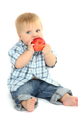 Little boy with red apple, isolated on white